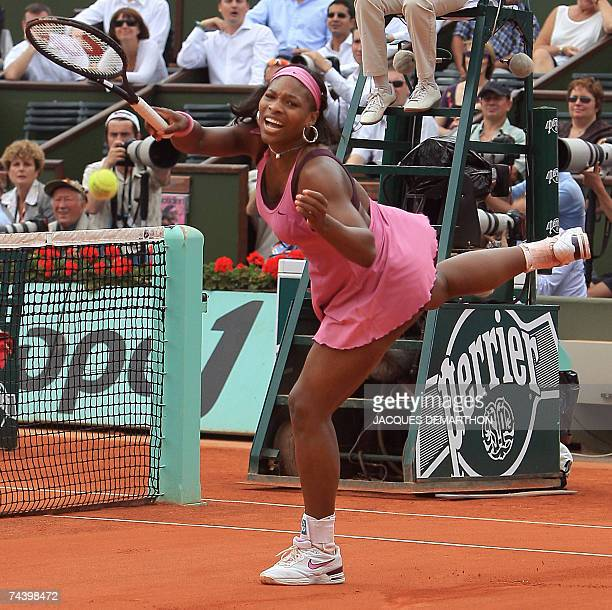 Player Serena Williams misses a ball against Belgian player Justine Henin during their French Tennis Open quarter final match at Roland Garros, 05...