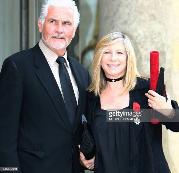 US singer Barbra Streisand poses with her husband James Brolin as she leaves the Elysee Palace after being awarded by French President Nicolas...