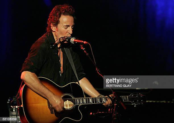 US singer Bruce Springsteen performs on stage 20 June 2005 at Bercy in Paris during an unplugged tour which follows his last album 'devils and dust'...