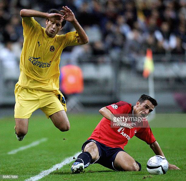Villareal's Italian Miedfilder Alessio Tacchinardi is tackled by Lille's Brazilian defender Rafael Schmitz during their Champions league group D...