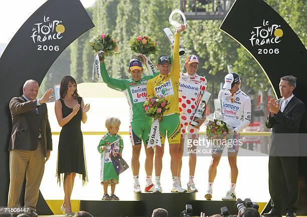 Yellow jersey USA's Floyd Landis celebrates with redandwhite polka dotted jersey Denmark's Michael Rasmussen green jersey Australia's Robbie McEwen...