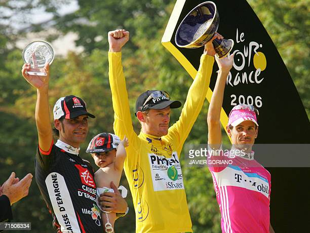 Yellow jersey USA's Floyd Landis celebrates with second placed overall Germany's Andreas Kloden and Spain's Oscar Pereiro Sio on the winners' podium...