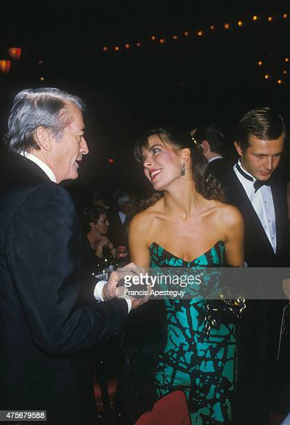 Paris France25/09/84Princess Caroline of Monaco with Gregory Peck at the Frank Sinatra concert at the Moulin Rouge to her left her husband Stefano...