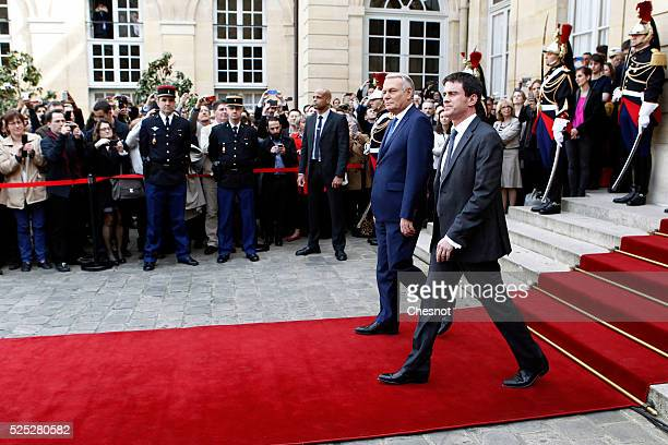 France's outgoing Prime minister JeanMarc Ayrault and France's newly appointed Prime minister Manuel Valls are seen during the take over ceremony on...
