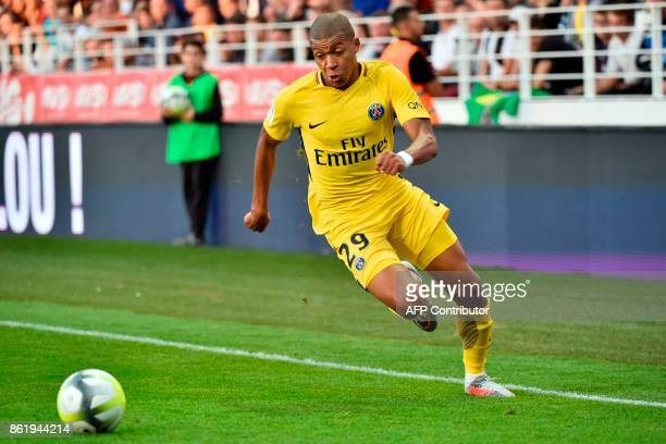 Paris' French forward Kylian Mbappe controls the ball during the French L1 football match between Dijon and Paris on October 14 at the GastonGerard...