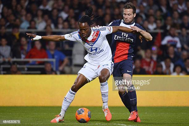 Paris' French midfielder Yohan Cabaye vies for the ball with Lyon's Burkinabese defender Bakary Kone during the French L1 football match between...
