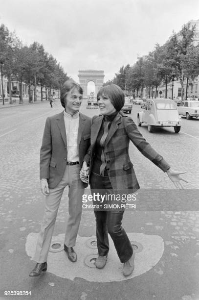 Paris French singer Claude François with his partner the Italian record producer and former singer Caterina Caselli