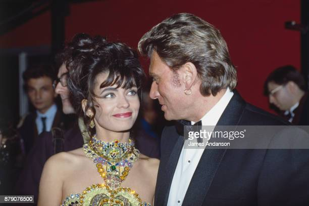 Paris French singer Johnny Hallyday and his wife Adeline at 6th ceremony of 'Victoires de la musique' 03nd February 1991