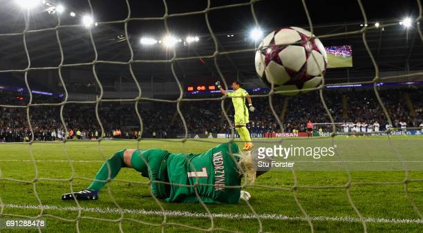 Paris goalkeeper Katarzyna Kiedrzynek reacts after Lyon goalkeeper Sarah Bouhaddi had scored the winning penalty during the UEFA Women's Champions...