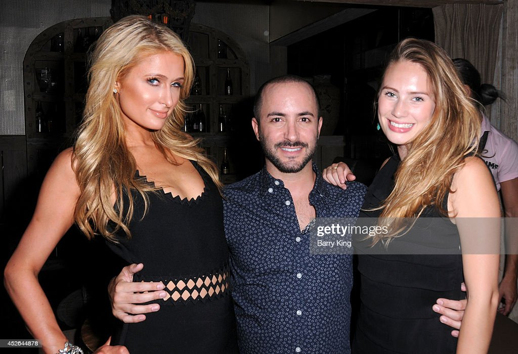 Paris Hilton, agent David Todd and actress Dylan Penn attend the DT Model Management 2 Year Anniversary Celebration on July 24, 2014 at Pump in West Hollywood, California.