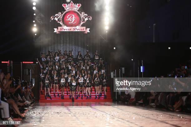 Paris Hilton along with Turkish models Cagla Sikel, Deniz Akkaya, Demet Sener, Sebnem Schaefer and Ozge Ulusoy walk down the stairs to present a...