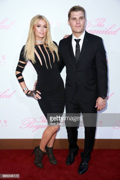 Paris Hilton and actor Chris Zylka attend the premiere of Focus Features' The Beguiled at the Directors Guild of America on June 12 2017 in Los...