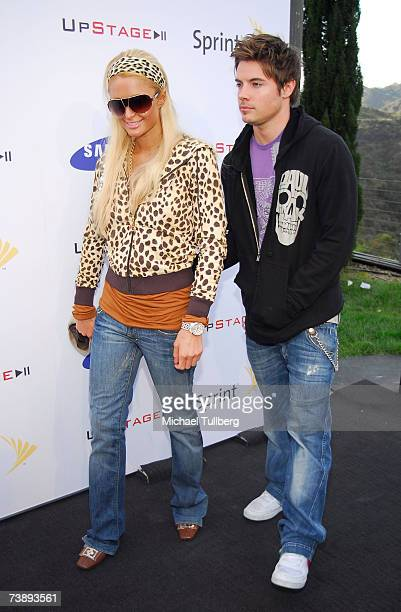 Paris Hilton and actor Josh Henderson arrive at the Upstage Country Club party thrown by Samsung and Sprint to celebrate the launch of Samsung's new...
