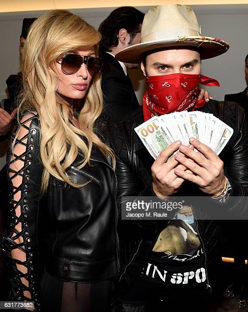 Paris Hilton and Alec Monopoly attend Philipp Plein Boutique Opening during Milan Men's Fashion Week Fall/Winter 2017/18 on January 15 2017 in Milan...