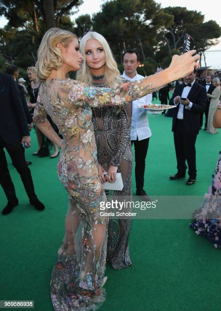 Paris Hilton and Anna Hiltrop attend the cocktail at the amfAR Gala Cannes 2018 at Hotel du CapEdenRoc on May 17 2018 in Cap d'Antibes France