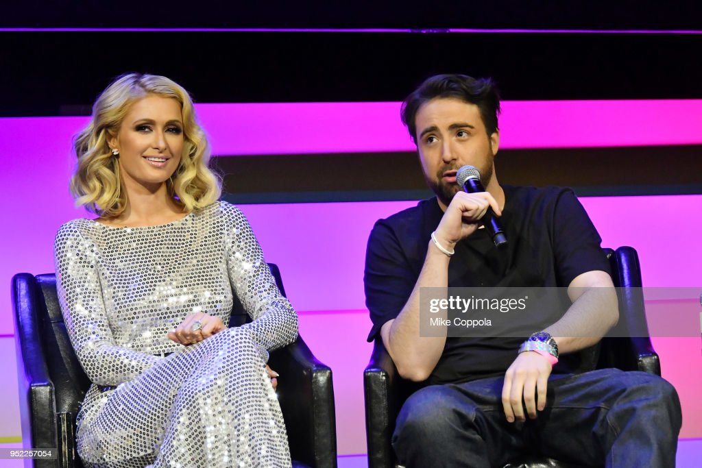 Paris Hilton and Bert Marcus speak onstage at the screening of 'The American Meme' during the 2018 Tribeca Film Festival at Spring Studios on April 27, 2018 in New York City.