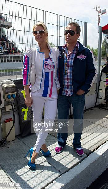 Paris Hilton and boyfriend Cy Waits in the pit during the 125 cc race of MotoGP of Catalunya at Montmelo Circuit on June 5 2011 in Montmelo Spain