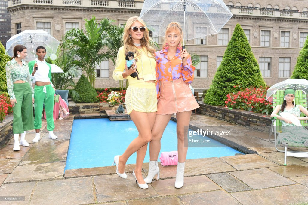 Paris Hilton and Brandi Howe (L-R) pose with models at the Juicy Couture presentation during New York Fashion Week at 620 Loft & Garden on September 13, 2017 in New York City.