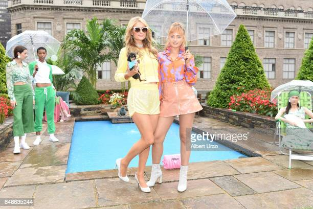 Paris Hilton and Brandi Howe pose with models at the Juicy Couture presentation during New York Fashion Week at 620 Loft Garden on September 13 2017...