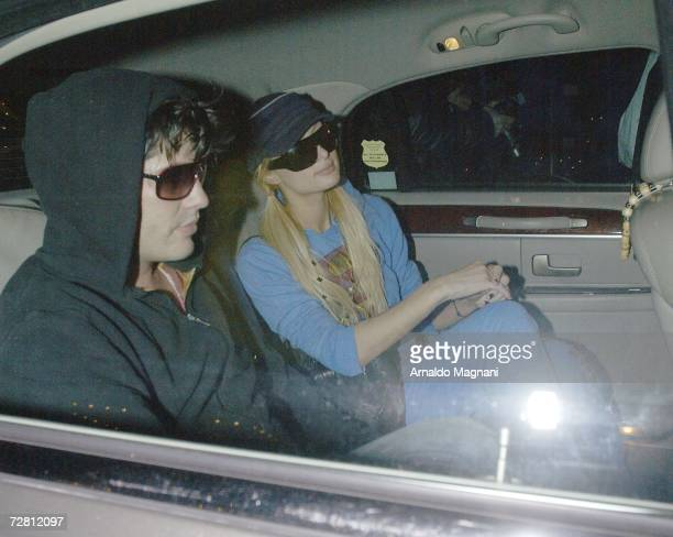 Paris Hilton and Brandon Davis leave Nello's restaurant in the back of a car after having dinner December 12, 2006 in New York.