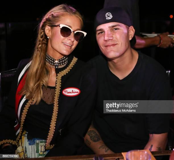 Paris Hilton and Cheia Zylka at Eden Roc Hotel on December 7 2017 in Miami Beach Florida