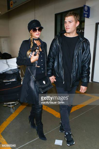Paris Hilton and Chris Zylka are seen at LAX on February 19 2017 in Los Angeles California