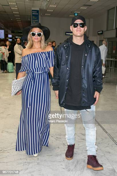 Paris Hilton and Chris Zylka are seen during the 71st annual Cannes Film Festival at Nice Airport on May 12 2018 in Nice France