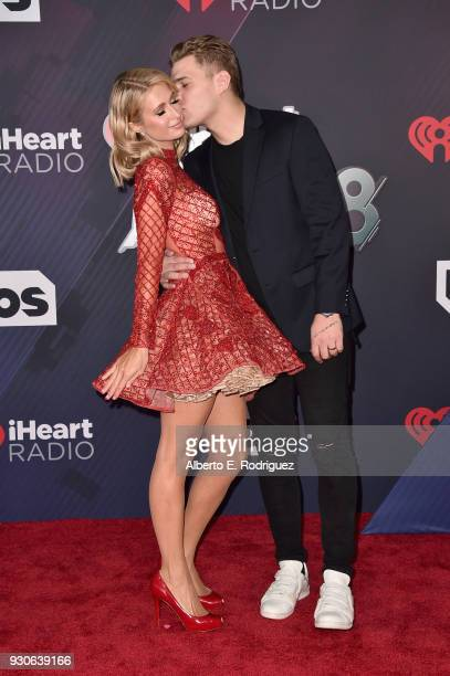Paris Hilton and Chris Zylka arrive at the 2018 iHeartRadio Music Awards which broadcasted live on TBS TNT and truTV at The Forum on March 11 2018 in...