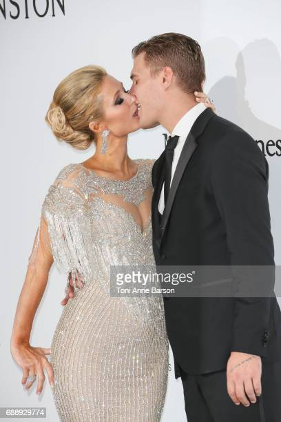Paris Hilton and Chris Zylka arrive at the amfAR Gala Cannes 2017 at Hotel du CapEdenRoc on May 25 2017 in Cap d'Antibes France