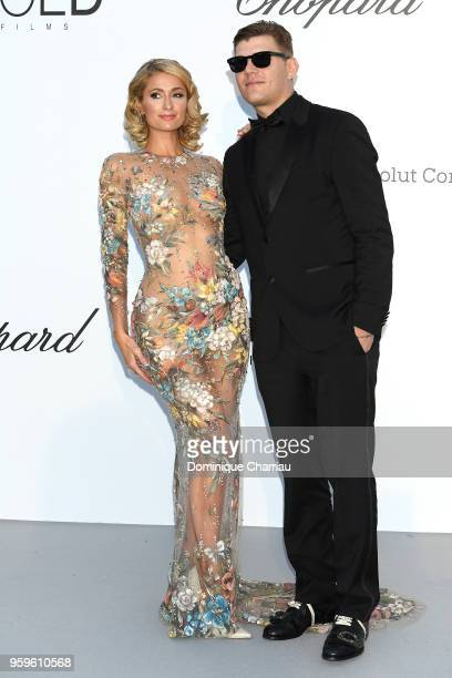 Paris Hilton and Chris Zylka arrive at the amfAR Gala Cannes 2018 at Hotel du CapEdenRoc on May 17 2018 in Cap d'Antibes France