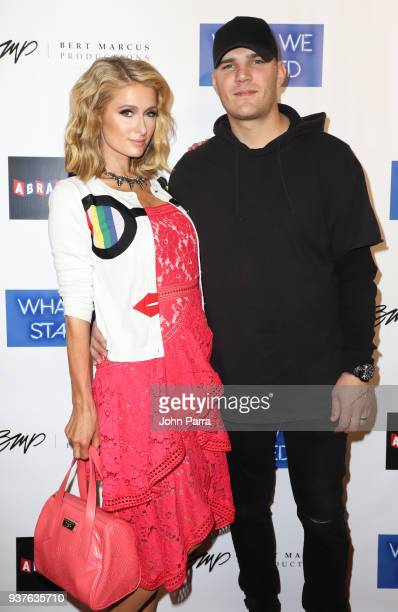 Paris Hilton and Chris Zylka arrive at 'What We Started' Miami Premiere on March 22 2018 in Miami Florida