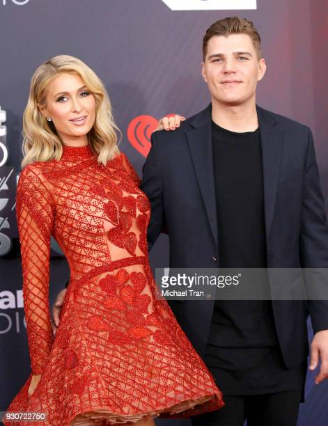 Paris Hilton and Chris Zylka arrive to the 2018 iHeartRadio Music Awards held at The Forum on March 11 2018 in Inglewood California