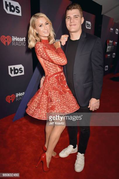Paris Hilton and Chris Zylka arrives at the 2018 iHeartRadio Music Awards which broadcasted live on TBS TNT and truTV at The Forum on March 11 2018...
