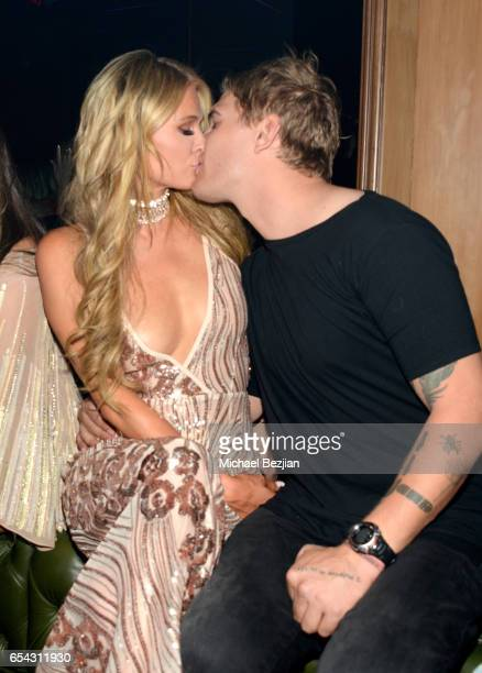 Paris Hilton and Chris Zylka attend day one of TAO Beauty Essex Avenue Luchini LA Grand Opening on March 16 2017 in Los Angeles California