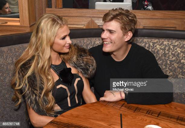 Paris Hilton and Chris Zylka attend day three of TAO Beauty Essex Avenue and Luchini LA Grand Opening on March 18 2017 in Los Angeles California