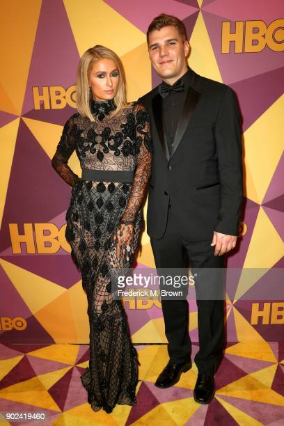 Paris Hilton and Chris Zylka attend HBO's Official Golden Globe Awards After Party at Circa 55 Restaurant on January 7 2018 in Los Angeles California