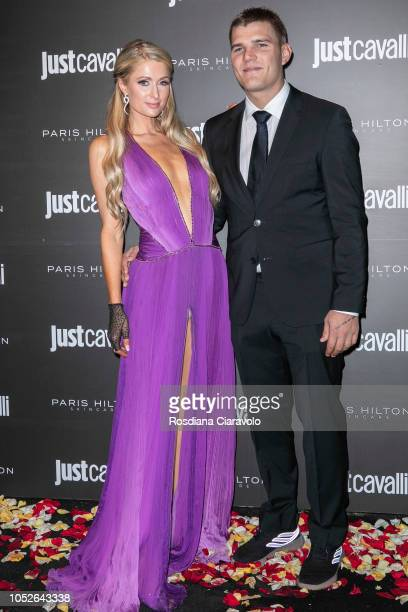 Paris Hilton and Chris Zylka attend Paris Hilton ProDNA lunch party at Just Cavalli Cafe on October 20 2018 in Milan Italy