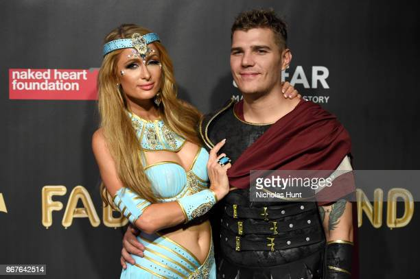Paris Hilton and Chris Zylka attend the 2017 amfAR The Naked Heart Foundation Fabulous Fund Fair at Skylight Clarkson Sq on October 28 2017 in New...