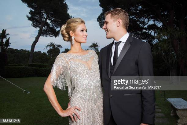 Paris Hilton and Chris Zylka attend the amfAR Gala Cannes 2017 at Hotel du CapEdenRoc on May 25 2017 in Cap d'Antibes France