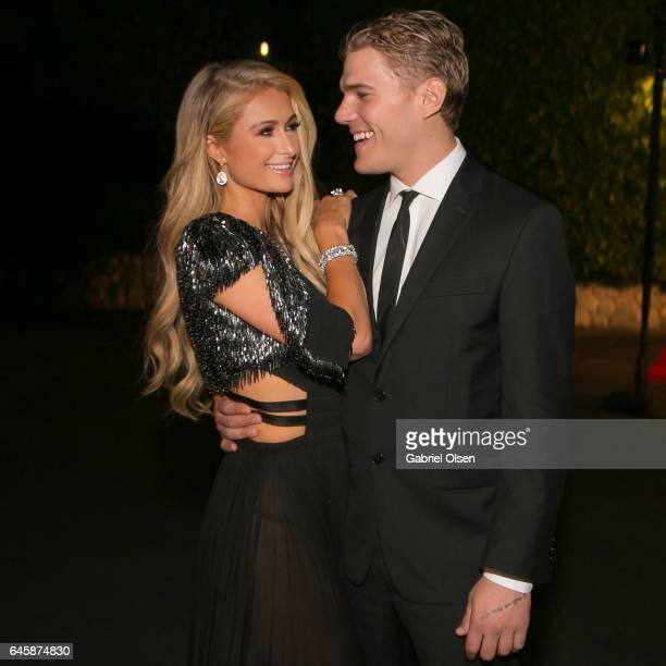 Paris Hilton and Chris Zylka attend the Circus Magazine Oscars Celebration Hosted By Steve Shaw and Jonas Tahlin CEO Absolut Elyx Sponsored by Volvo...