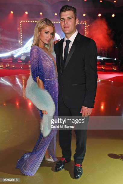 Paris Hilton and Chris Zylka attend the de Grisogono party during the 71st annual Cannes Film Festival at Villa des Oliviers on May 15 2018 in Cap...
