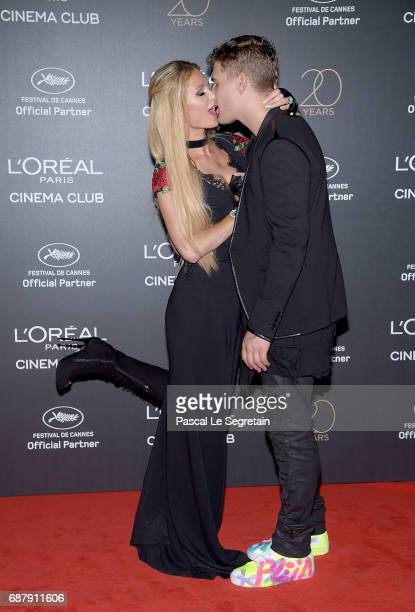 Paris Hilton and Chris Zylka attend the Gala 20th Birthday Of L'Oreal In Cannes during the 70th annual Cannes Film Festival at Martinez Hotel on May...