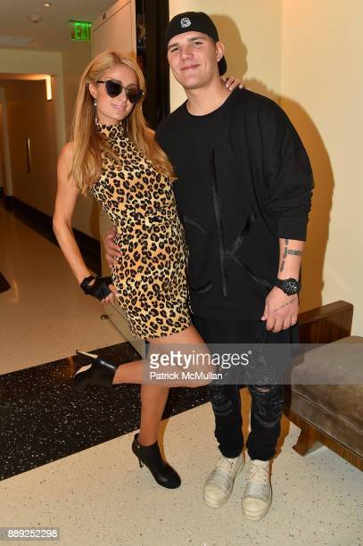 Paris Hilton and Chris Zylka attend the Galerie Gmurzynska Dinner in Honor of Jean Pigozzi at the Penthouse at the Faena Hotel Miami Beach on...
