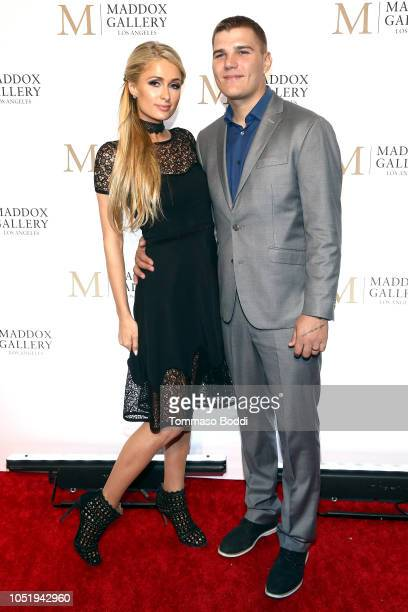 Paris Hilton and Chris Zylka attend the Grand Opening Maddox Gallery Los Angeles on October 11 2018 in West Hollywood California