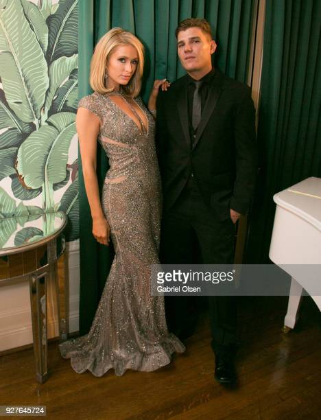 Paris Hilton and Chris Zylka attend the Treats annual Oscars party at the private residence of Jonas Tahlin CEO of Absolut Elyx on March 4 2018 in...