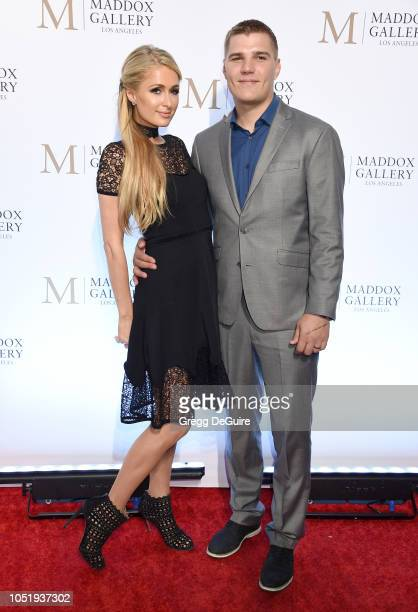 Paris Hilton and Chris Zylka attend the ViP Opening of Maddox Gallery Exhibition Best Of British at Maddox Gallery on October 11 2018 in Los Angeles...