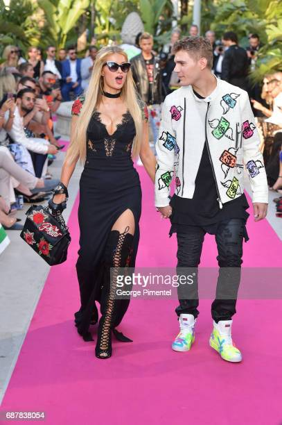 Paris Hilton and Chris Zylka attends the/walks the runway at the Philipp Plein Cruise Show 2018 during the 70th annual Cannes Film Festival at on May...