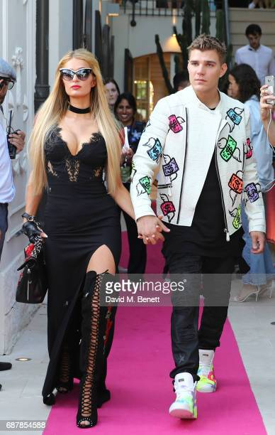 Paris Hilton and Chris Zylka walk the runway at the Philipp Plein Cruise Show 2018 during the 70th annual Cannes Film Festival at on May 24 2017 in...