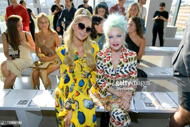 Paris Hilton and Cyndi Lauper attend Libertine fashion show during New York Fashion Week The Shows at Gallery II at Spring Studios on September 11...