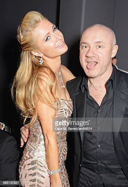 Paris Hilton and Damien Hirst attend amfAR's 21st Cinema Against AIDS Gala presented by WORLDVIEW BOLD FILMS and BVLGARI at Hotel du CapEdenRoc on...